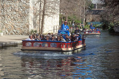 Sight Seeing Barge on the River Walk. This boat takes tourists along the river through the River Walk in San Antonio, Texas. It gives you a different perspective Stock Photography
