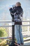 Sight seeing through binoculars Stock Photos