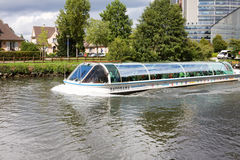 A sight-seeing boat on Ill river in Strasbourg Royalty Free Stock Photography