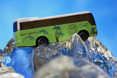 Sight seeing bus model. On ice rocks Royalty Free Stock Photos