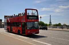 Sight seeing bus tour paris. A shot of a tour bus with eifel tower in the back going Stock Photos