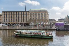 Sight seeing ship in Hamburg, Germany. HAMBURG - APRIL 25: People making a city trip with a sight seeing ship on April 25, 2013 in the harbor and canals of Stock Photo