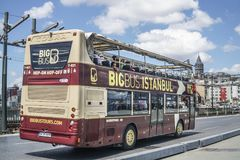 Sight seeing tourist bus passing through Galata Bridge, famous bridge that spans the Golden Horn in Istanbul, Turkey. Stock Photography