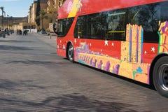 Sight seeing tourist bus. At Cordoba old down beside the roman bridge Stock Photo