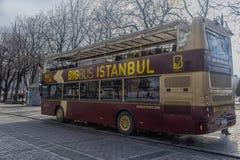 Sight seeing tourist bus. Turkey, Istanbul, 11,03,2018    Sight seeing tourist bus BigBus passing through Galata Bridge, famous bridge that spans the Golden Royalty Free Stock Images