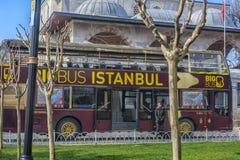 Sight seeing tourist bus. Turkey, Istanbul, 11,03,2018    Sight seeing tourist bus BigBus passing through Galata Bridge, famous bridge that spans the Golden Royalty Free Stock Photos