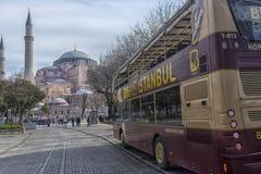 Sight seeing tourist bus. Turkey, Istanbul, 11,03,2018    Sight seeing tourist bus BigBus passing through Galata Bridge, famous bridge that spans the Golden Royalty Free Stock Photo