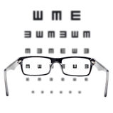Sight test seen through eye glasses Stock Photos