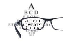 Sight test seen through eye glasses Stock Image