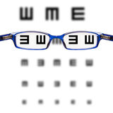 Sight test seen through eye glasses Stock Photo