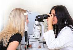 The sight testing. The photographic session in the optical institution Royalty Free Stock Photos