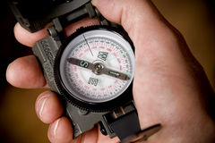 Sighting compass. Hand of a hiker holding sighting compass stock photography