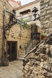 Sights and streets of the old town of Budva, Montenegro. Ancient Stone houses and walls in the center of the city with stairs and. Small shops and old lanterns stock photos
