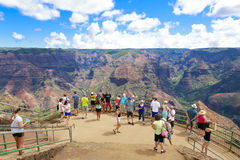 Sightseeing area in Waimea Canyon, Hawaiian islands,. Tourists enjoying picturesque view of Waimea Canyon on observation deck. Hawaiian islands Stock Photography