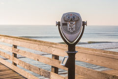 Sightseeing binoculars on Pier. Sightseeing binoculars on the Virginia Beach fishing pier Royalty Free Stock Image