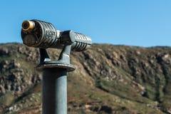 Sightseeing Binoculars Pointed at Mountain Range. Stock Image