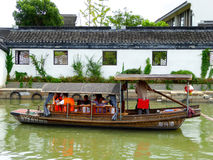 Sightseeing Boat from ancient town Stock Photos
