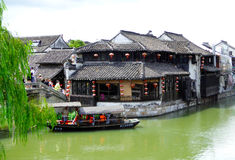 Sightseeing Boat and buildings from ancient town Royalty Free Stock Images