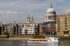 Sightseeing boat filled with tourists on river Thames in London,. Water taxi boat filled with tourists on river Thames in London, England stock photography