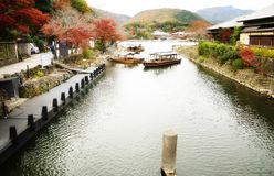 The sightseeing boat in Kyoto. Japan during autumn with mountain background Royalty Free Stock Photos