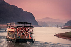 Sightseeing boat in Periyar. SIghtseeing touristic boat on the lake in the Periyar National Park, India royalty free stock images