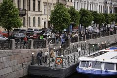 Sightseeing boat on the river Fontanka. SAINT-PETERSBURG, RUSSIA - JUNE 12, 2015: People waiting to board a sightseeing boat on the river Fontanka.  June 12 Royalty Free Stock Photos