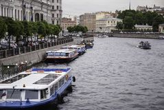 Sightseeing boat on the river Fontanka. SAINT-PETERSBURG, RUSSIA - JUNE 12, 2015: People waiting to board a sightseeing boat on the river Fontanka.  June 12 Stock Photography