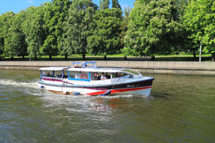 Sightseeing boat on the river Stock Images