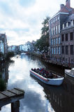 Sightseeing boat tour in Gent, Belgium. Tourists view the city on a sightseeing boat in Ghent, Belgium Stock Photo