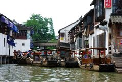 Sightseeing boats at jetty  on canal in Zhujiajiao. Boats at jetty  on canal in Zhujiajiao an ancient water town with a history of more than 1700 years. It is Royalty Free Stock Images