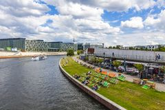 Sightseeing boats on the river Spree in Berlin, Germany. BERLIN, GERMANY - JULY 1, 2014: Sightseeing boats on the river Spree in a sunny summer day in center of Royalty Free Stock Image