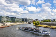 Sightseeing boats on the river Spree in Berlin, Germany. BERLIN, GERMANY - JULY 1, 2014: Sightseeing boats on the river Spree in a sunny summer day in center of Stock Photo