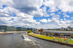 Sightseeing boats on the river Spree in Berlin, Germany. BERLIN, GERMANY - JULY 1, 2014: Sightseeing boats on the river Spree in a sunny summer day in center of Royalty Free Stock Photography