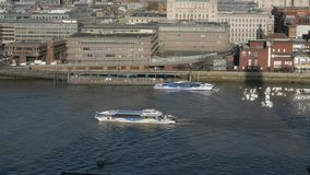 Sightseeing boats on River Thames in London stock video