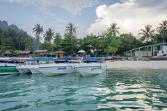 Sightseeing boats stand on the beach, waiting for tourists. Crabi, Thailand - January 4: Krabi is a province of Thailand. Tourists sail from the island to the Stock Photography