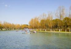 Sightseeing boats. Tourists taking boats traveling Century park Shanghai China Stock Images