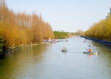 Sightseeing boats. Tourists taking boats traveling Century park Shanghai China Royalty Free Stock Photos