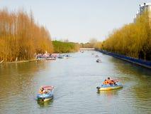 Sightseeing boats. Tourists taking boats traveling Century park Shanghai China Royalty Free Stock Images