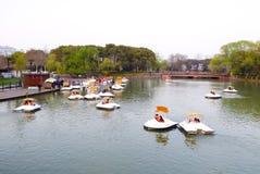 Sightseeing boats. Tourists taking boats traveling Century park Shanghai China Stock Image