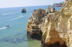 Sightseeing boats with vacationing tourist. Seen along Algarve coast of Atlantic Ocean in proximity to Lagos in Portugal Royalty Free Stock Images