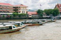 Sightseeing boats waiting for tourists. BANGKOK - JUNE 30, 2015: Sightseeing boats waiting for tourists on Chao Phraya river Stock Photo