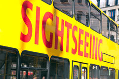 Sightseeing bus. A side of a city sightseeing bus Stock Images