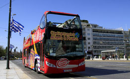 Sightseeing Bus Athens & Piraeus. Thursday, April 21, 2011: A city sightseeing bus full with tourists is driving on the route in the center of Athens, Greece Royalty Free Stock Photos