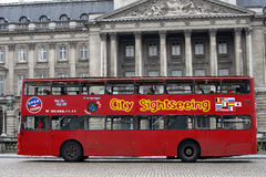 Sightseeing Bus in Bruxelles. Thursday, October 13, 2009: A city sightseeing bus with tourists is driving on the route in the center of Brussels, Belgium royalty free stock images