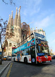Sightseeing bus in front of Sagrada Familia. Sightseeing bus with tourists in front of Sagrada Familia Barcelona, Catalunya Royalty Free Stock Image