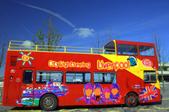 Sightseeing bus in Liverpool. Sightseeing bus with colourful pictures of Beatles in Liverpool Royalty Free Stock Images