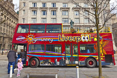 Sightseeing bus in Liverpool. LIVERPOOL, UK - MAY 3, 2015: Sight seeing open top bus at the city centre decorated with images of local attractions Royalty Free Stock Image
