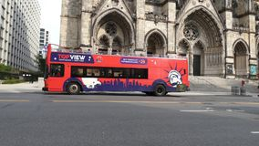 Sightseeing Bus. A sightseeing bus in front of the cathedral of St. John the Divine, in New York City stock video