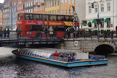 Sightseeing bus and tour boat in Copenhagen, Denmark Stock Photo