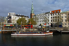 Sightseeing bus and tour boat in Copenhagen, Denmark Stock Image